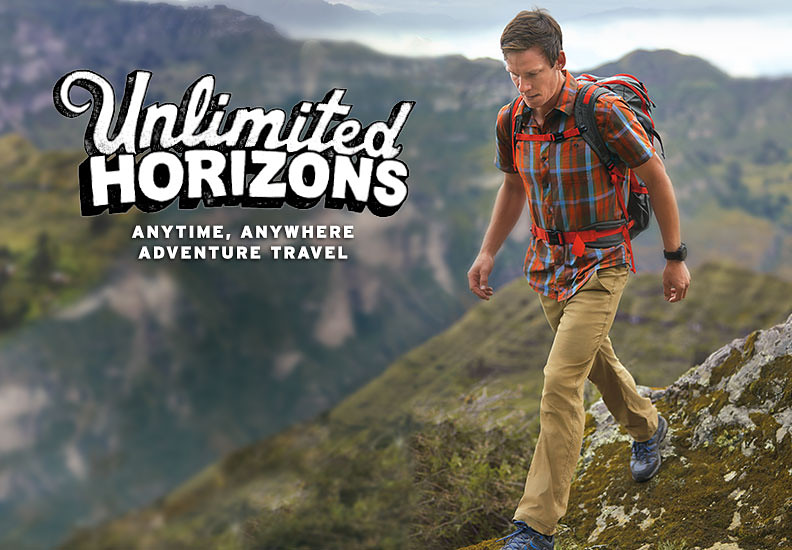 A man wearing Horizon pants hikes in the mountains in Peru
