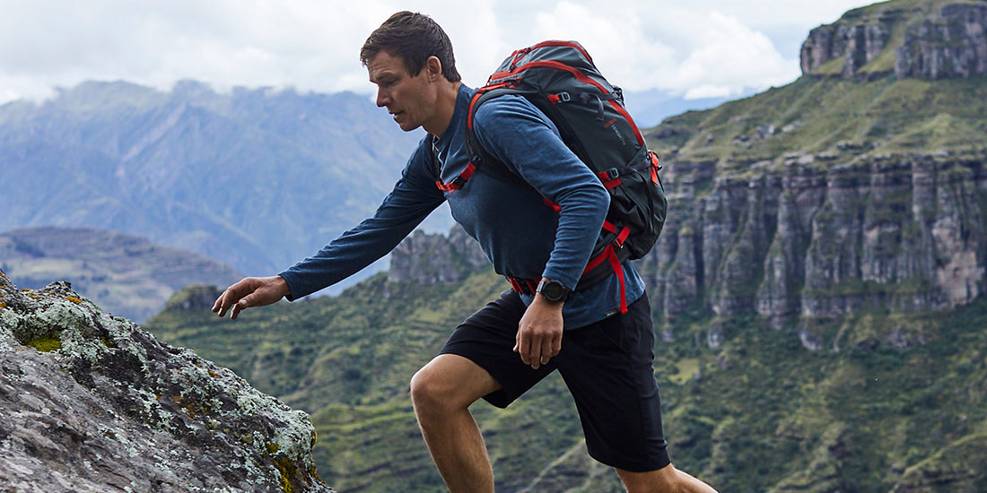 A man wearing a Contour Performance Crew hikes in the mountains of Peru