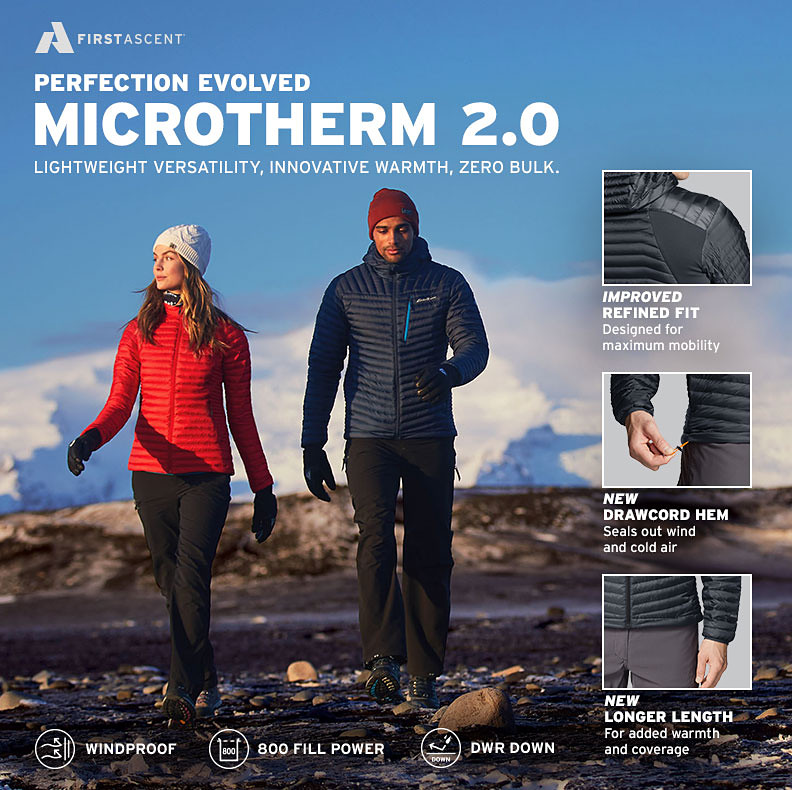 Two people in MicroTherm Jackets walk in the a mountainous landscape