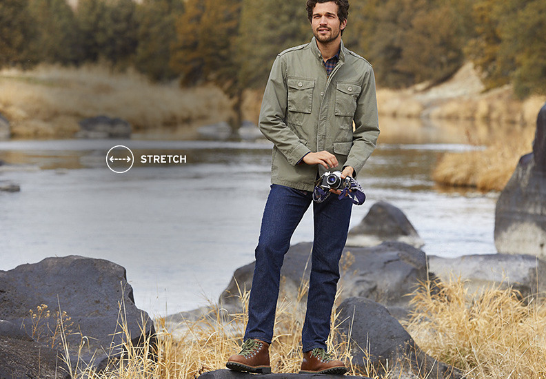 A man wearing Flex jeans stands by a river