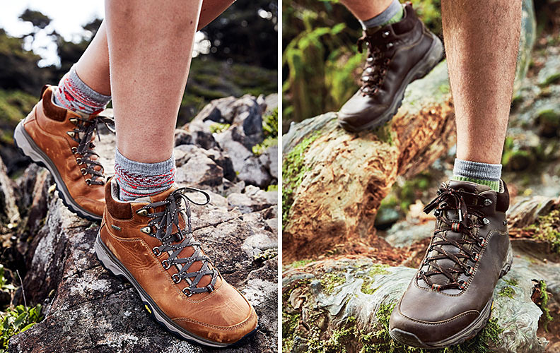 Side-by-side images of Cairn Mid Boots worn by woman and man standing on rocks