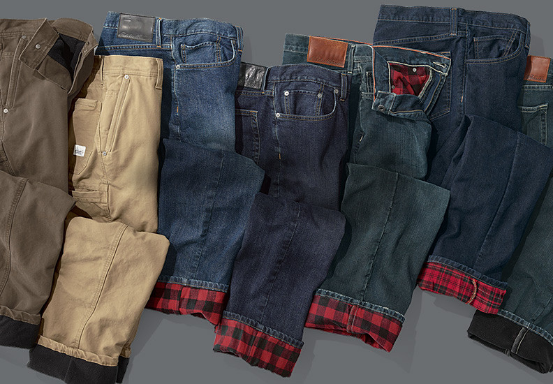 Line up of jeans and other pants with cuffs turned up to show lining.