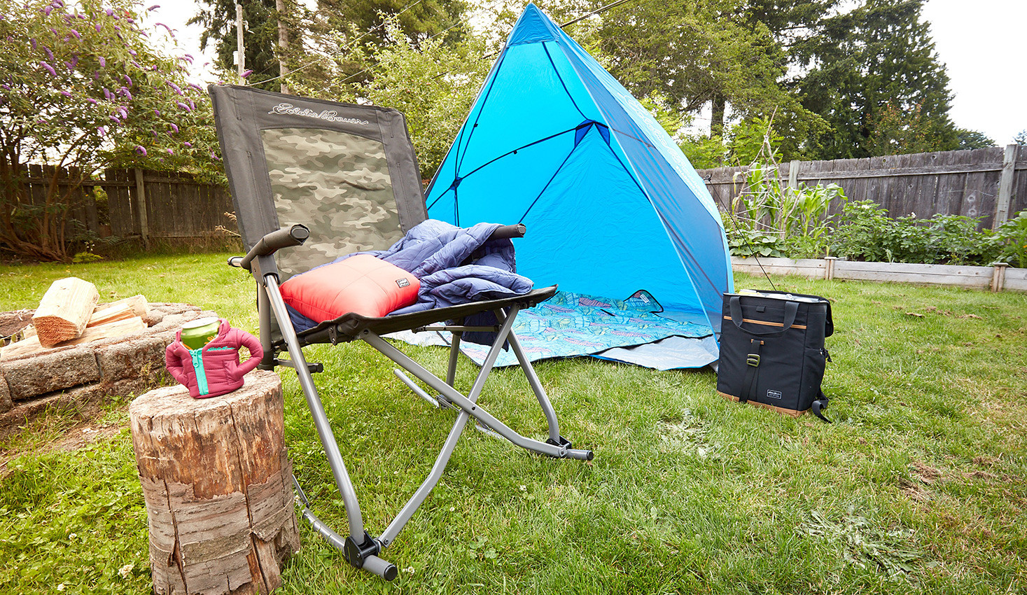 Camp chair sitting beside a tent outdoors